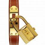 Relógio Hermès Kelly, caixa em plaque ouro, pulseria em pele, 2000 €